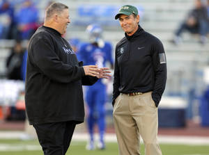 Photo - Kansas Jayhawks head coach Charlie Weis, left, and Baylor Bears head coach Art Briles talk prior to an NCAA college football game Saturday, Oct. 26, 2013, in Lawrence, Kan. (AP Photo/Ed Zurga)