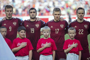 Photo - Top row from left Russia's national soccer team players Alexander Kokorin, Alexander Samedov, Oleg Shatov and Andrey Eshenko listen to Russia's national anthem before a friendly soccer match against Morocco in Moscow, Russia, Friday, June 6, 2014. Russia won 2-0. This is the last friendly match before the Russian team leave for Brazil to compete in the World Cup. (AP Photo/Pavel Golovkin)