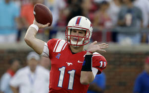 Photo - FILE - IN this Aug. 30, 2013, file photo, SMU quarterback Garrett Gilbert throws a pass during the first half of an NCAA college football game against Texas Tech in Dallas. Four months after relaunching his sports agency, Leigh Steinberg has signed Gilbert as his first football client. (AP Photo/LM Otero, File)