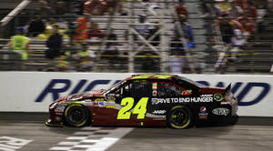 Photo -   Jeff Gordon (24) makes his way past the start/finish line during the NASCAR Sprint Cup Series auto race at the Richmond International Raceway in Richmond, Va., Sunday, Sept. 9, 2012. (AP Photo/Steve Helber)