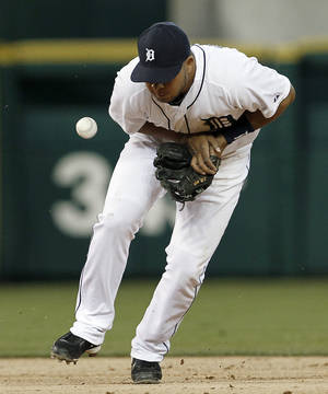 photo -   Detroit Tigers shortstop Jhonny Peralta bobbles a Seattle Mariners' Casper Wells ground ball in the third inning of a baseball game in Detroit, Wednesday, April 25, 2012. Peralta was charged with an error on the play. (AP Photo/Paul Sancya)
