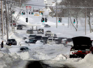 photo - Stranded vehicles litter the roadway along Route 25 in Lake Grove, N.Y., Saturday, Feb. 9, 2013. Many people abandoned their vehicles along Long Island roadways after they became stuck in the rapidly falling snow. Frist responders rescued a number of people from stranded cars, some having spent the night in frigid temperatures.  (AP Photo/Newsday, Ed Betz) NYC LOCALS OUT; NO SALES
