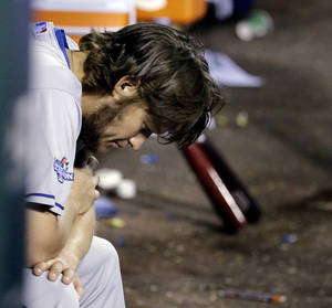 Photo - Los Angeles Dodgers starting pitcher Clayton Kershaw holds his head down in the dugout after being taken out of the game during the fifth inning of Game 6 of the National League baseball championship series against the St. Louis Cardinals, Friday, Oct. 18, 2013, in St. Louis. (AP Photo/David J. Phillip)