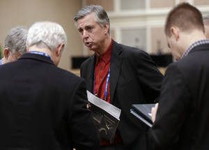 Photo - Detroit Tigers general manager David Dombrowski, center, talks with reporters following the Rule 5 draft at the baseball winter meetings on Thursday, Dec. 6, 2012, in Nashville, Tenn. (AP Photo/Mark Humphrey)