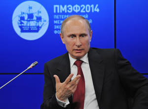 "Photo - Russian President Vladimir Putin speaks during a plenary session of the St. Petersburg International Investment Forum Friday, May 23, 2014. Putin said Friday at an investment forum that Russia will ""respect the choice of the Ukrainian people."" He said that Russia wants peace and order to be restored in Ukraine. (AP Photo/RIA Novosti Kremlin, Mikhail Klimentyev, Presidential Press Service)"