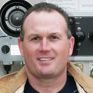 photo - SHOOTING DEATH: Devin Nemecek, 47, a retired Yukon firefighter, was killed Tuesday, April 19, 2011, in a shooting at 317 Sunrise Drive in Yukon, police said. An off-duty Piedmont police officer shot Nemecek as Nemecek barged into the officer&#039;s Yukon home and attacked him. Nemecek&#039;s family said he suffered lung and heart problems while injured on the job and used oxygen to breathe. Nemecek&#039;s family said they think he was having hallucinations due to low oxygen levels and was confused when he barged into the officer&#039;s home. Provided by Yukon police.        ORG XMIT: 1104192228193571