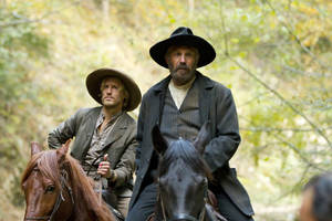 Matt Barr, left, and Kevin Costner are shown in a scene from Hatfields &amp; McCoys. The miniseries will receive the Outstanding Television Film-Docudrama prize in April at the Wrangler Awards in Oklahoma City. Proto provided by the History Channel