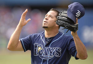 Photo - Tampa Rays relief pitcher Joel Peralta reacts after getting out of a jam with an inning-ending double play in the seventh of a baseball game against the Toronto Blue Jays, Sunday Sept. 29, 2013 in Toronto. (AP Photo/The Canadian Press, Frank Gunn)