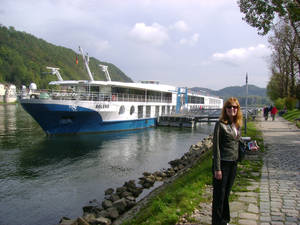 Photo - This 2012 photo shows Betty Adams in Passau, Germany, with the MS Bolero, a Viking River Cruises ship. Adams took a cruise on the Danube River with her husband Glenn Adams but the couple missed a connection with a flight en route to the first departure port. They took a next-day flight and managed to get to the ship in time, but they were glad to have travel insurance to cover costs associated with the scrambled plans. Many travel experts recommend insurance for complicated itineraries, including cruises.  (AP Photo/Glenn Adams)
