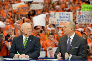 Photo -  ESPN college basketball analysts Digger Phelps, left, and Jay Bilas talk on the set of College GameDay in the Carrier Dome in Syracuse, N.Y. on February 1, 2014. Phelps and Bilas will be in Gallagher-Iba Arena on Saturday to preview Oklahoma State vs. Kansas. PHOTO BY ALLEN KEE, ESPN Images