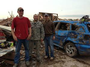 Photo - U.S. Air Force Tech. Sgt. Daniel Dashiell, left, Tech. Sgt. Nick Boyer and Tech. Sgt. Robert Lewis stand in front of the remains of the Dashiell home in Moore. <strong> - PROVIDED</strong>
