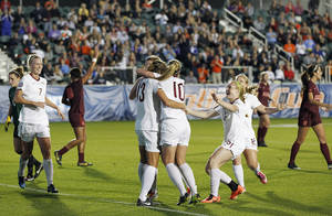 Photo - Florida State players, from left, Dagny Brynjarsdottir, Kassey Kallman, Kristin Grubka, Berglind Thorvaldsdottir, Kacy Scarpa, and Michaela Hahn celebrate Grubka's goal during the first half of an NCAA college soccer semifinal match at the Women's College Cup tournament in Cary, N.C., Friday, Dec. 6, 2013. (AP Photo/Ellen Ozier)