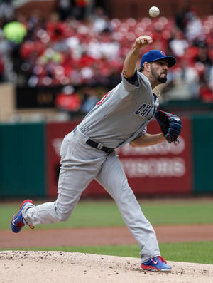 Photo - Chicago Cubs starting pitcher Jason Hammel delivers a pitch to a St. Louis Cardinals batter during the first inning of a baseball game Thursday, May 15, 2014, in St. Louis. (AP Photo/Sarah Conard)