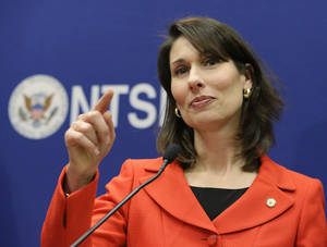 "photo - National Transportation Safety Board Chairman Deborah Hersman points to a reporter during a news conference at the NTSB in Washington, Thursday, Jan. 24, 2013. The Boeing 787 Dreamliner battery that caught fire earlier this month in Boston shows evidence of short-circuiting and a chemical reaction known as ""thermal runaway,"" in which an increase in temperature causes progressively hotter temperatures, federal accident investigators said. -It's not clear to investigators which came first, the short-circuiting or the thermal runaway, Hersman said. Nor is it clear yet what caused either of them, she said. (AP Photo/Manuel Balce Ceneta)"