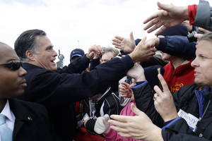 Photo -   Republican presidential candidate, former Massachusetts Gov. Mitt Romney greets supporters after he spoke about the economy at a campaign rally at Kinzler Construction Services in Ames, Iowa, Friday, Oct. 26, 2012. (AP Photo/Charles Dharapak)