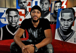 Photo - Ray Tennyson, who graduated from Midwest City High School, has made a full-time job out of his art after his Thunder paintings became popular. Photo by Chris Landsberger, The Oklahoman