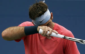 Photo - Juan Martin Del Potro, of Argentina, prepares to serve to Guillermo Garcia-Lopez, of Spain, during the first round of the 2013 U.S. Open tennis tournament, Wednesday, Aug. 28, 2013, in New York. (AP Photo/Kathy Willens)