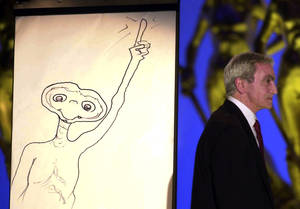 "Photo -   FILE - This April 10, 2002 file photo shows special effects artist Carlo Rambaldi walking on stage after drawing a cartoon of ET during the Italian David Di Donatello cinema awards in Rome's Cinecitta' studios. Rambaldi who won three Oscars for the special effecs of ""King Kong"" by John Guillermin, ""Alien"" by Ridley Scott and ""E.T. the Extra-Terrestrial"" by Steven Spielberg, died in Lamezia Terme, Italy, Friday Aug. 10, 2012. He was 86. (AP Photo/Gregorio Borgia, FILE)"