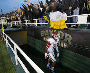 Photo - Baylor fans shout as Oklahoma's Lacoltan Bester (11) walks towards the field prior to an NCAA college football game between the University of Oklahoman (OU) Sooners and the Baylor Bears at Floyd Casey Stadium in Waco, Texas, Thursday, Nov. 7, 2013. Photo by Bryan Terry, The Oklahoman