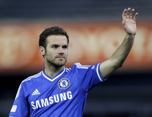 Photo - FILE - This is a Saturday, May 25, 2013, file photo of Chelsea modfielder Juan Mata gestures toward spectators at the end of an friendly soccer match against Manchester City at Yankee Stadium in New York. Mata is edging closer to joining Manchester United from Chelsea. In a sign that Mata's Chelsea exit is nearing, a person familiar with the situation says the midfielder didn't train with the first team on Wednesday Jan. 22, 2014.  (AP Photo/Julio Cortez, File)