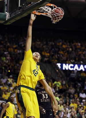 Photo - Baylor's Brittney Griner (42) dunks over Florida State's Natasha Howard (33) in the second half of a second-round game in the women's NCAA college basketball tournament Tuesday, March 26, 2013, in Waco, Texas. Baylor won 85-47. (AP Photo/Tony Gutierrez)