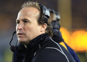 photo - West Virginia coach Dana Holgorsen watches during the second half of his team's 55-14 loss to Kansas State in an NCAA college football game in Morgantown, W.Va., Saturday, Oct. 20, 2012. (AP Photo/Christopher Jackson)   ORG XMIT: WVCJ118
