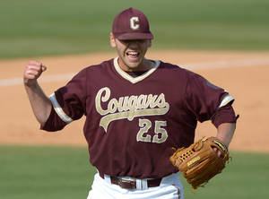 Photo - College of Charleston pitcher Tyler Thornton celebrates after getting the final out of a complete game 4-2 win over Long Beach State in an NCAA college baseball regional tournament game in Gainesville, Fla., Monday, June 2, 2014.(AP Photo/Phelan M. Ebenhack)
