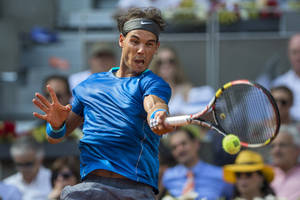 Photo - Rafael Nadal from Spain returns the ball during a Madrid Open tennis tournament semifinal match against Roberto Bautista Agut from Spain in Madrid, Spain, Saturday, May 10, 2014. (AP Photo/Andres Kudacki)