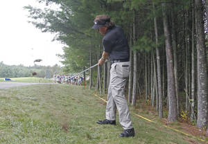 Photo - Phil Mickelson hits his second shot on the 10th hole during the second round of the Deutsche Bank Championship golf tournament in Norton, Mass., Saturday, Aug. 31, 2013. (AP Photo/Stew Milne)
