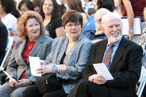 Photo - Tom Boyd sits next to daughter Katrina and wife Barbara at a ceremony in his honor on the University of Oklahoma campus. PHOTOS BY STEVE SISNEY, THE OKLAHOMAN