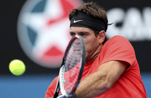 Photo - Juan Martin del Potro of Argentina plays a backhand shot in his match against Nicolas Mahut of France during the Sydney International Tennis Tournament in Sydney, Australia, Wednesday, Jan. 8, 2014. (AP Photo/Rob Griffith)