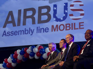 Photo -   Officials attend ceremonies announcing that Airbus will establish its first assembly plant in the United States in Mobile, Ala., Monday, July 2, 2012. From left: Barry Eccleston, Airbus President & CEO Fabrice Bregier, Alabama Gov. Robert Bentley and Mobile, Ala. Mayor Sam Jones. The French-based company said the Alabama plant is expected to cost $600 million to build and will employ 1,000 people when it reaches full production, likely to be four planes a month by 2017. (AP Photo/Dave Martin)