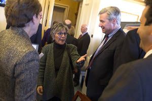 Photo - Senate Environment and Public Works Committee Chairman Sen. Barbara Boxer, D-Calif. talks with Senators during a meeting of the Senate Climate Action Task Force prior to taking to the Senate Floor all night to urge action on climate change on Capitol Hill on Monday, March 10, 2014, in Washington. From left,  Sen. Jeanne Shaheen, D-N.H, Boxer, Sen. Sheldon Whitehouse, D-R.I., and Sen. Brian Schatz, D-Hawaii. (AP Photo/ Evan Vucci)