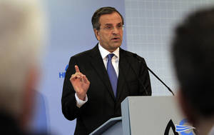 Photo - Greek Prime Minister Antonis Samaras, delivers a speech during the inauguration of the annual Thessaloniki International Trade Fair Saturday Sept. 7, 2013. Labor unions are planing a series of weekend demonstrations in the country's second largest city, demanding a reversal of minimum wage cuts imposed in the bailed out country last year. His government is facing confrontation with unions over plans to begin mass firings and forced transfers of public sector workers. (AP Photo/Nikolas Giakoumidis)