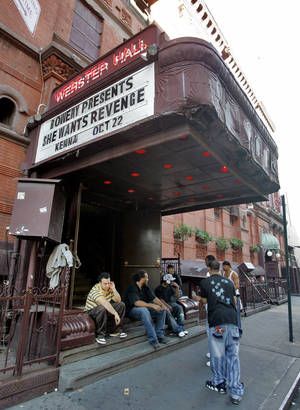 Photo -   FILE- In this Oct. 22, 2007 file photo, workers at New York's Webster Hall take a break under the marquee. The New York City music venue shut its doors for the night after two people were injured on Friday, July 6, 2012, in what authorities say was a biting and slashing attack. (AP Photo/Richard Drew, File)