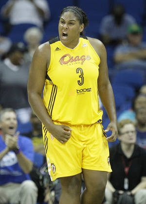 Photo - Courtney Paris of the Tulsa Shock celebrates during their game against the Seattle Storm June 15, 2014. MIKE SIMONS/Tulsa World