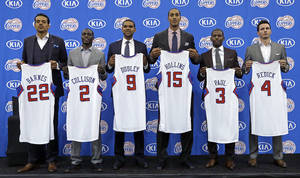 Photo - Los Angeles Clippers' Matt Barnes, Darren Collison, Jared Dudley, Ryan Hollins, Chris Paul and J.J. Redick holds jerseys as the Clippers announce updates and additions to their NBA basketball roster, at their headquarters in Los Angeles on Wednesday, July 10, 2013. (AP Photo/Reed Saxon)