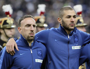 Photo - FILE - In this Nov. 19, 2013 file photo, From left, Franck Ribery, left, and Karim Benzema pay attention to the French national anthem during a World Cup qualifying playoff second-leg soccer match France against Ukraine at Stade de France stadium in Saint Denis, outside Paris.  A trial involving Bayern Munich winger Franck Ribery and Real Madrid forward Karim Benzema is back on track Monday Jan.20, 2014, with the two facing up to three years in prison on charges of soliciting an underage prostitute. (AP Photo/Michel Euler, File)