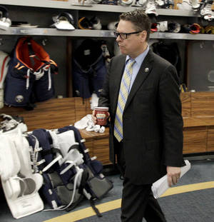 Photo - Buffalo Sabres general manager Tim Murray exits the Sabres locker room after players gathered for the last time on Monday, April 14, 2014, in Buffalo, N.Y. (AP Photo/Nick LoVerde)