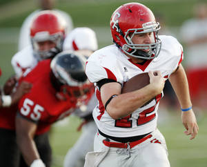 Photo - Carl Albert's Taylor Hawkins carries the ball during a high school football scrimmage at Del City High School in Del City, Okla., Friday, Aug. 19, 2011. Photo by Nate Billings, The Oklahoman ORG XMIT: KOD