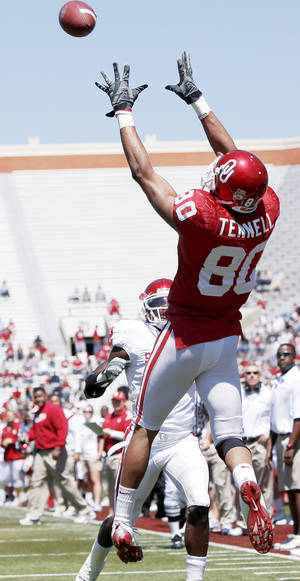 Photo - Adron Tennell leaps to catch a 23-yard touchdown pass Saturday in Norman.  Photo by Bryan Terry, The Oklahoman