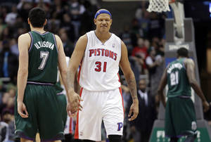 Photo - Detroit Pistons' Charlie Villanueva reacts after making a 3-point basket in the final seconds of an NBA basketball game against the Milwaukee Bucks Saturday, Feb. 9, 2013, in Milwaukee. (AP Photo/Morry Gash)