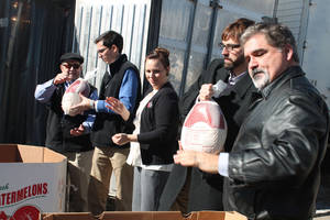 Photo - Staff from the GableGotwals law firm deliver turkeys to the Jesus House for the charity's 2013 Thanksgiving food baskets.Photo provided <strong></strong>