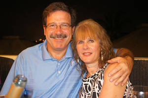 Photo - In this undated photo provided by Mark Sherlach, Mark Sherlach and his wife, school psychologist Mary Sherlach, pose for a photo. Mary Sherlach was killed Friday, Dec. 14, 2012, when a gunman opened fire at Sandy Hook Elementary School, in Newtown, Conn., killing 26 children and adults at the school. (AP Photo/Courtesy of Mark Sherlach)