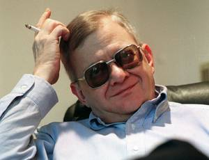 Photo - FILE - In this Feb. 4, 1998 file photo, writer Tom Clancy appears at his home in Calvert County, Md. Clancy, the bestselling author of more than 25 fiction and nonfiction books for the Penguin Group, died on Oct. 1, 2013 in Baltimore, Md. He was 66.  (AP Photo/Vince Lupo)