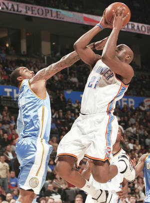 photo - The Nuggets' J.R. Smith tries to stop the Thunder's Damien Wilkins in the first half at the Ford Center on Friday. Photo by Steve Sisney, The Oklahoman