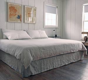 Photo - Designer Richard Ostell is partial to linens like these from Rough Linen, of Marin, Calif. The linen doesn?t come cheap. Rough Linen sells queen-size sheets for $154 each, a queen duvet cover can run $350, and napkins cost $20 to $24 each. <strong> - PROVIDED BY RICHARD OSTELL</strong>