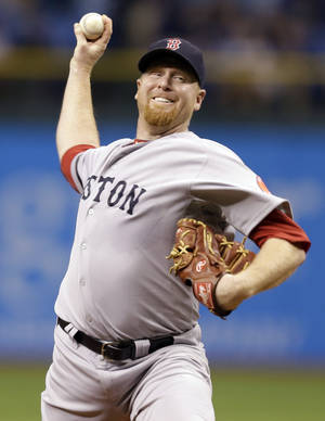 Photo -   Boston Red Sox starting pitcher Aaron Cook delivers to the Tampa Bay Rays during the first inning of a baseball game, Monday, Sept. 17, 2012, in St. Petersburg, Fla. (AP Photo/Chris O'Meara)