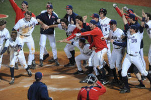 Photo - Mississippi players celebrate Austin Anderson's three-run walk-off home run in the 13th inning against Auburn in an NCAA college baseball game in Oxford, Miss., on Friday, April 4, 2014. Mississippi won 8-5. (AP Photo/Oxford Eagle, Bruce Newman) MANDATORY CREDIT  MAGS OUT  NO SALES