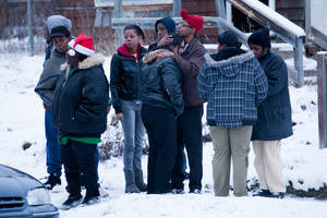 Photo - CORRECTS TO THREE PEOPLE DEAD NOT FIVE Friends and family members console each other, Tuesday, Dec. 25, 2012 in Flint, Mich. Michigan authorities say three people are dead in Flint from what is believed to be accidental carbon monoxide poisoning. (AP Photo/Flint Journal, Griffin Moores)